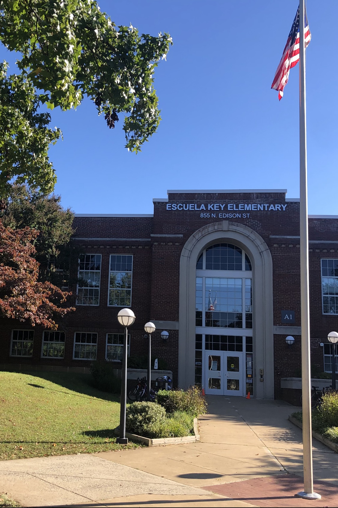 front of school with flag